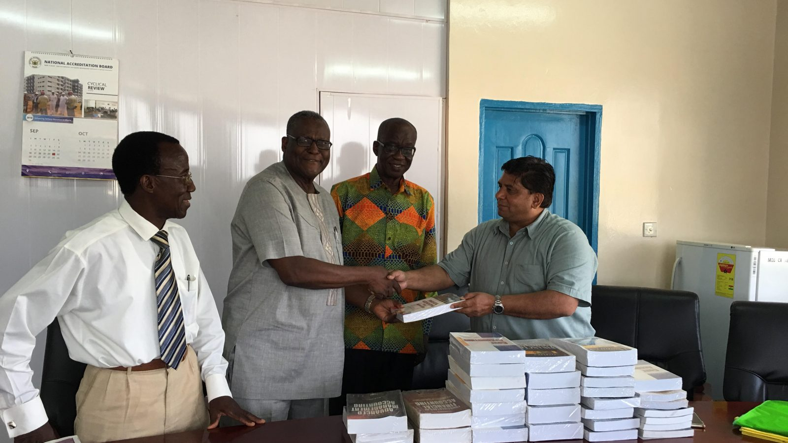 Mr. Vimal Nayyar donating the books to the Deputy Rector (Academic and Student Affairs)